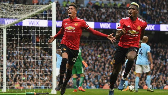 Chris Smalling celebrates scoring United's winner at City.