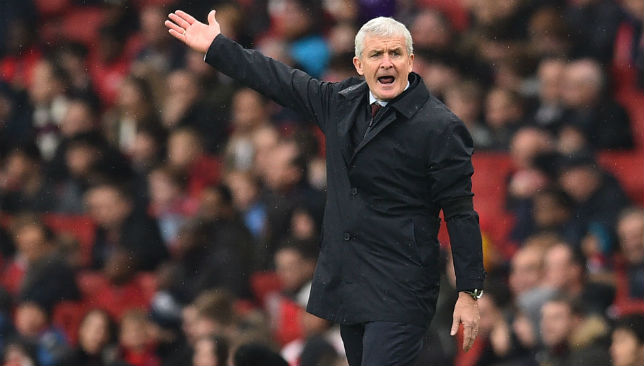 Mark Hughes giving instructions to his team.