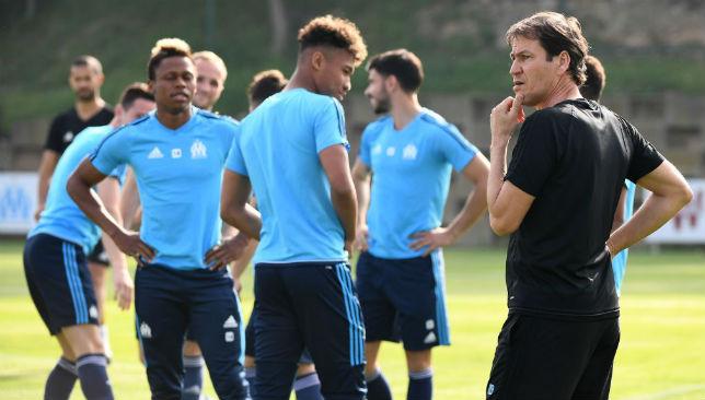 Marseille head coach Rudi Garcia speaks with his players.