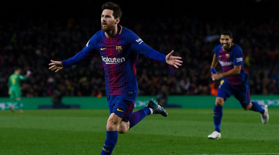 ... match Ronaldo's Champions League group goal record. Lionel Messi  celebrates