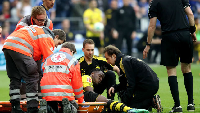 Chelsea's Michy Batshuayi stretchered off for Dortmund amid reports of broken ankle