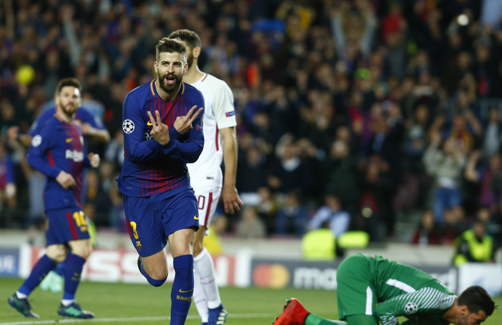 Pique celebrates after his goal last night