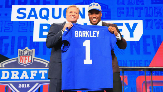 Saquon Barkley of Penn State poses with NFL Commissioner Roger Goodell after being picked #2