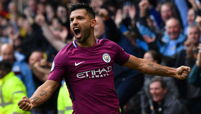 Sergio Aguero celebrates scoring his third