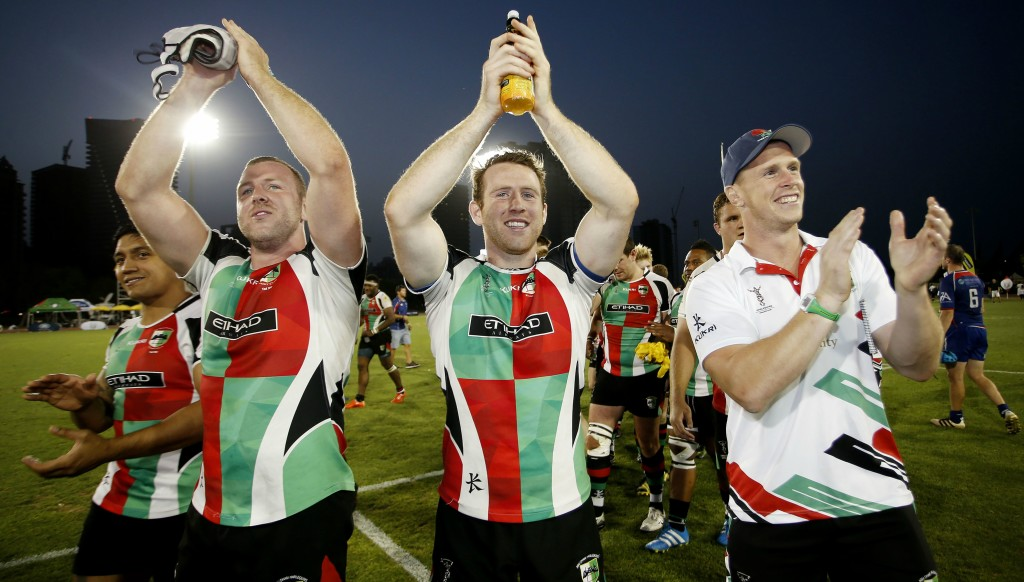 Mike McFarlane (r) celebrates last year's UAE Premiership final triumph with Ben Bolger (l) and brother Sam Bolger.