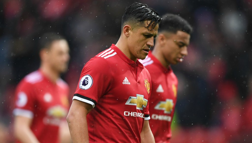 Alexis Sanchez trudges off the Old Trafford turf after a dismal 1-0 defeat to doomed West Brom.