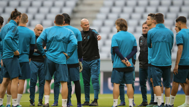 Zidane, Manager of Real Madrid talks to players
