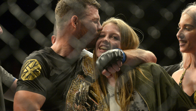 Michael Bisping with daughter Ellie on the night he won the UFC Middleweight title