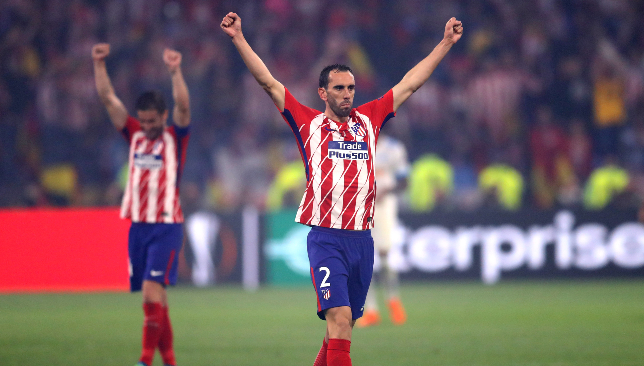 Diego Godin celebrates Europa League success in Lyon.