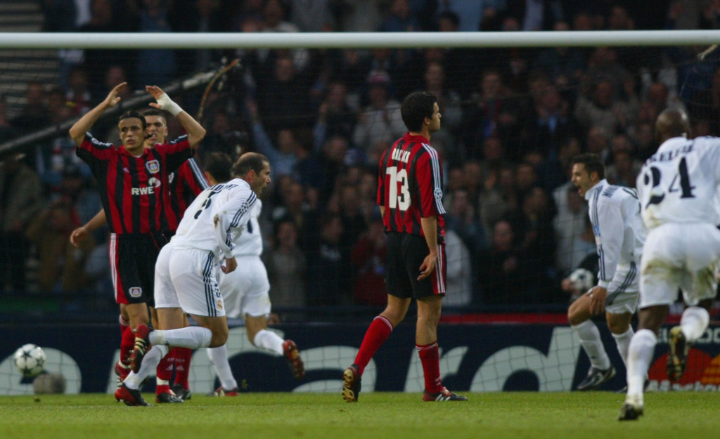 GLASGOW, UNITED KINGDOM: Real Madrid's Zinedine Zidane scores the second goal during the Champions League final opposing Real Madrid to Bayern Leverkusen, 15 May 2002 in Glasgow. AFP PHOTO ADRIAN DENNIS (Photo credit should read ADRIAN DENNIS/AFP/Getty Images)