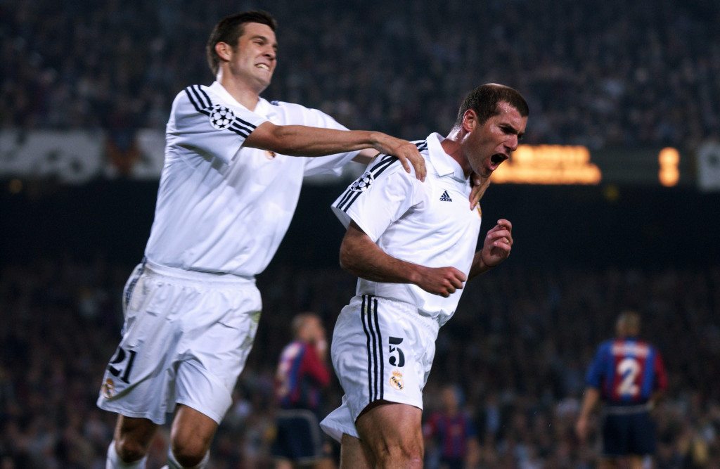 BARCELONA - APRIL 23: Zinedine Zidane of Real Madrid celebrates scoring the opening goal of the match with team-mate Santiago Solari during the UEFA Champions League semi-final first leg match between Barcelona and Real Madrid played at the Nou Camp, in Barcelona, Spain on April 23, 2002. Real Madrid won the match 2-0. DIGITAL IMAGE. (Photo by Clive Brunskill/Getty Images)
