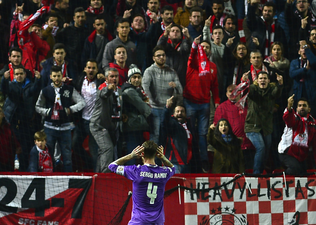 Real Madrid's defender Sergio Ramos celebrates after scoring a goal during the Spanish Copa del Rey (King's Cup) round of 16 second leg football match Sevilla FC vs Real Madrid CF at the Ramon Sanchez Pizjuan stadium in Sevilla on January 12, 2017. / AFP / CRISTINA QUICLER (Photo credit should read CRISTINA QUICLER/AFP/Getty Images)