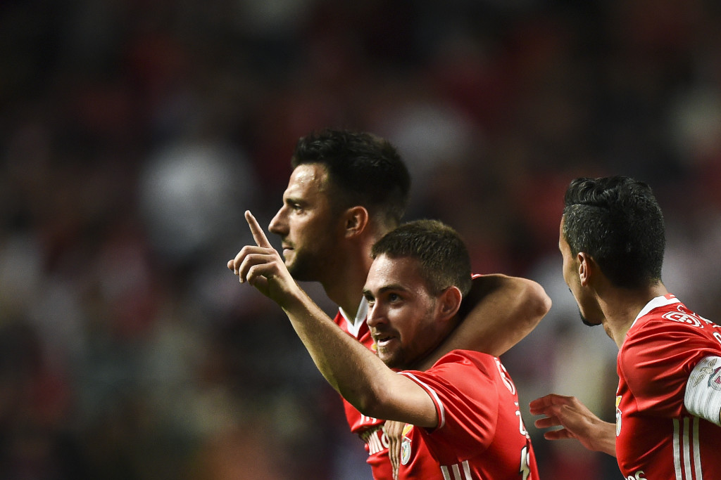 Benfica's Serbian forward Andrija Zivkovic celebrates with his teammates Benfica's defender Andre Almeida and Benfica's Greek midfielder Andreas Samaris after scoring during the Portuguese Cup semi-final second leg football match SL Benfica