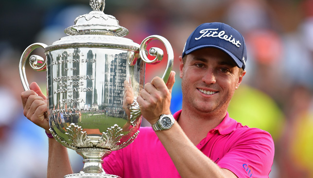Thomas win the PGA Championship trophy.