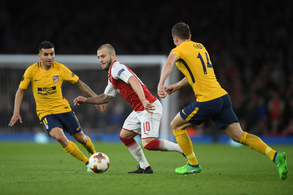 LONDON, ENGLAND - APRIL 26: Jack Wilshere of Arsenal is challenged by Angel Correa and Gabi of Atl?tico Madrid during the UEFA Europa League Semi Final leg one match between Arsenal FC and Atletico Madrid at Emirates Stadium on April 26, 2018 in London, United Kingdom. (Photo by Mike Hewitt/Getty Images)