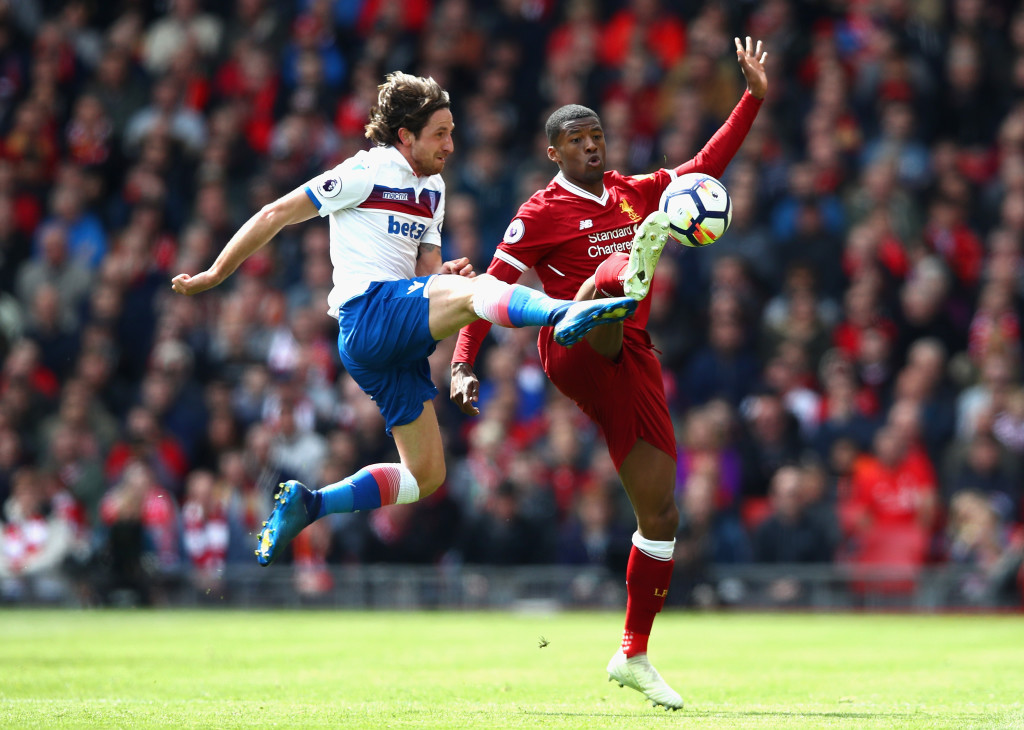 LIVERPOOL, ENGLAND - APRIL 28:  Georginio Wijnaldum of Liverpool and Joe Allen of Stoke City clash during the Premier League match between Liverpool and Stoke City at Anfield on April 28, 2018 in Liverpool, England.  (Photo by Clive Brunskill/Getty Images)
