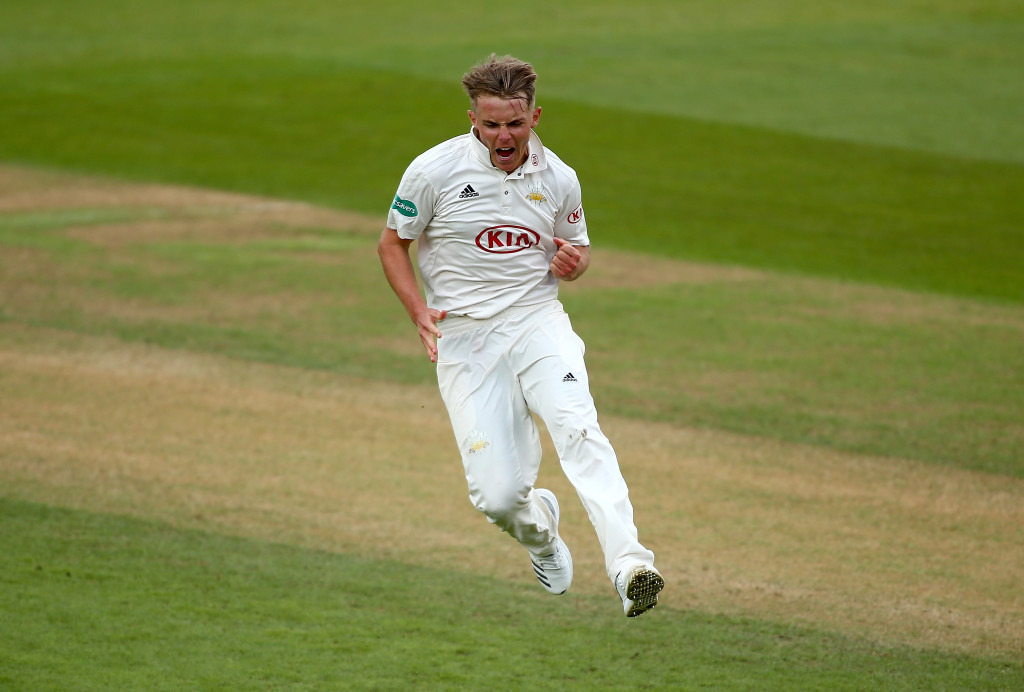 Sam Curran of Surrey celebrates dismissing Cheteshwar Pujara of Yorkshire.