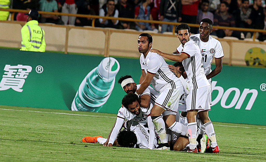 Al Jazira players celebrate Romarinho's goal.