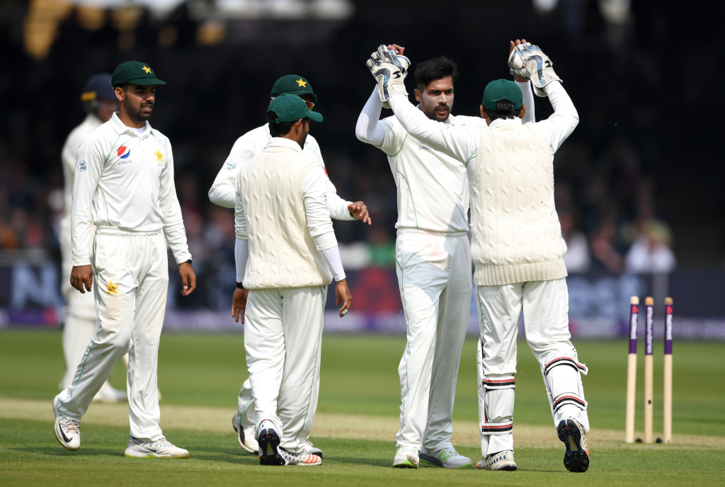 LONDON, ENGLAND - MAY 24: Mohammad Amir of Pakistan celebrates dismissing Alastair Cook of England during the NatWest 1st Test match between England and Pakistan at Lord's Cricket Ground on May 24, 2018 in London, England. (Photo by Gareth Copley/Getty Images)