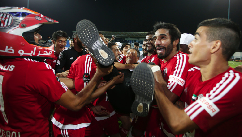 Jazira coach Henk ten Cate is hoisted high by his players after winning the 2016/17 AGL title.