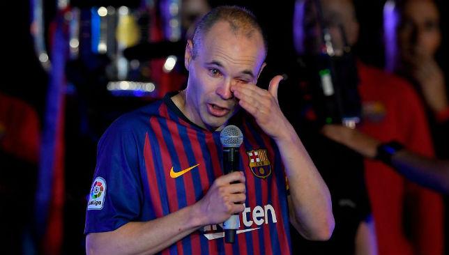 Iniesta wipes his tears