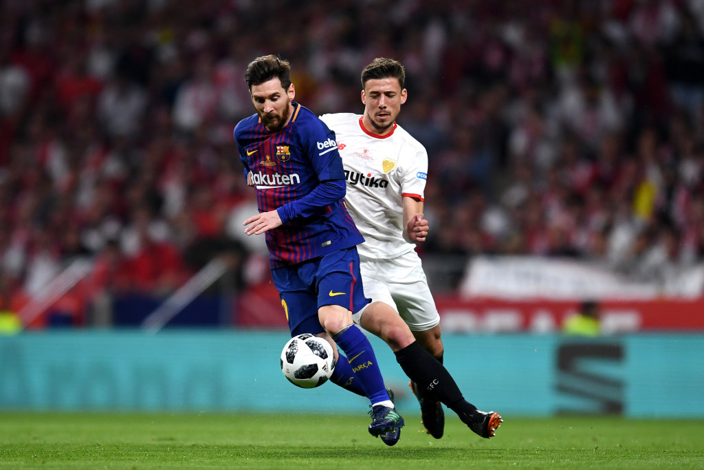 Lionel Messi holds off Clement Lenglet of Sevilla, who joined Barcelona this summer.