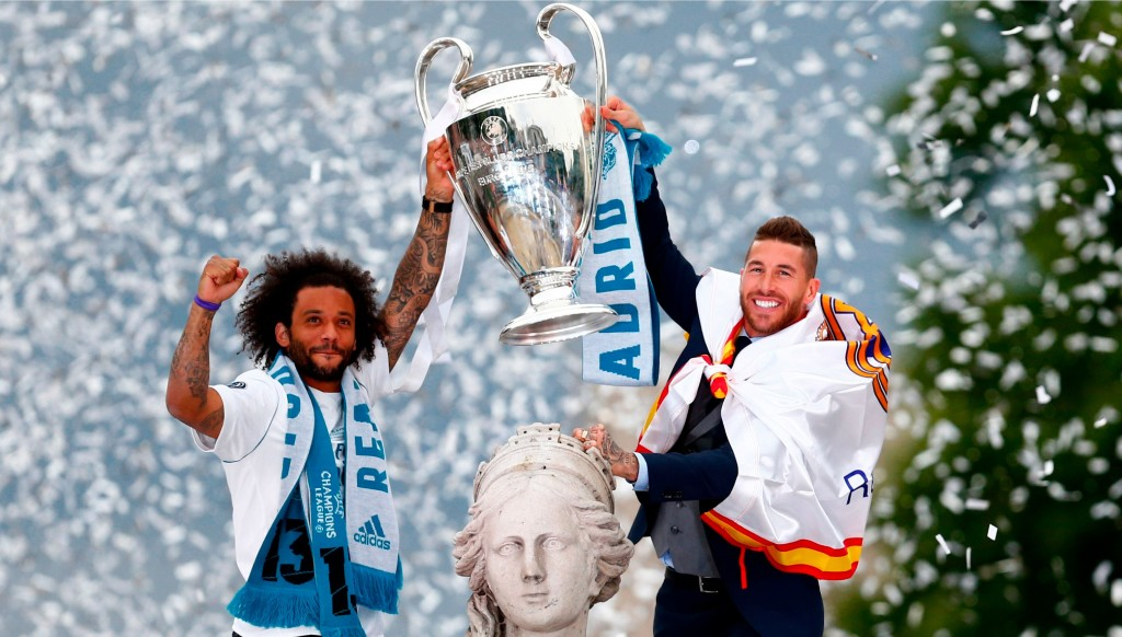 Joy for Hala Madrid as Marcello and Ramos hold the trophy aloft.