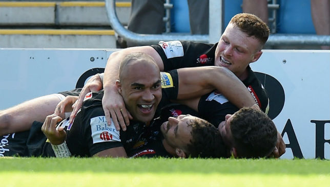 Olly Woodburn of Exeter Chiefs celebrates scoring a try