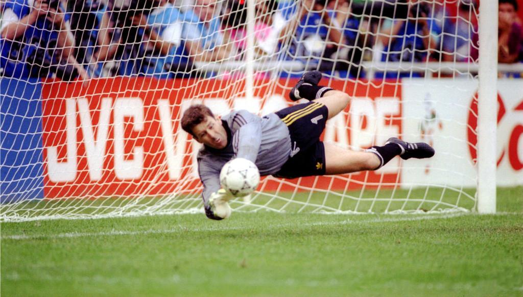Pat Bonner saves a penalty as Ireland overcame Romania in a shootout.