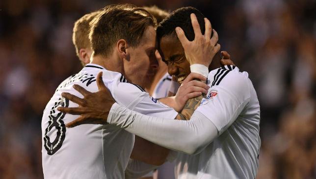 Ryan Sessegnon of Fulham celebrates with team mate Stefan Johansen