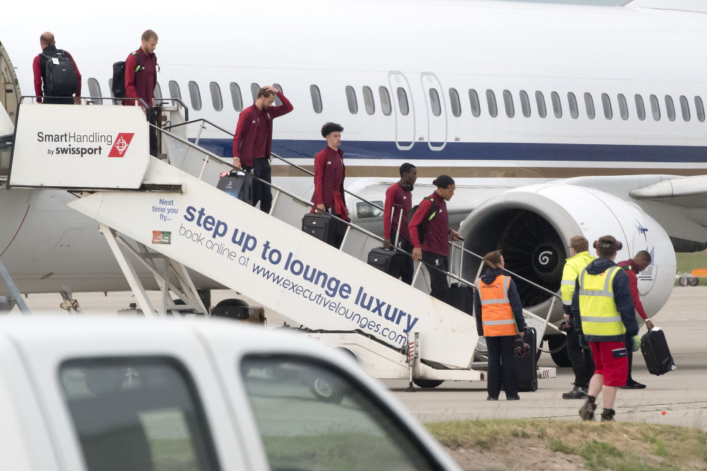 Liverpool players get off the plane at John Lennon Airport after defeat in the UEFA Champions League Final against Real Madrid in Kiev. PRESS ASSOCIATION Photo. Picture date: Sunday May 27, 2018. See PA story SOCCER Liverpool. Photo credit should read: Anthony Devlin/PA Wire