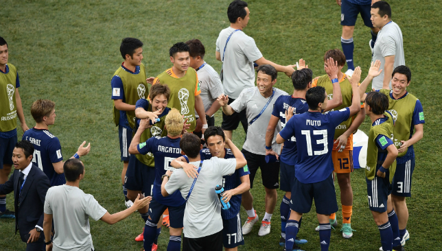 Japan qualified by the skin of their teeth after a farcical end to their 1-0 loss.