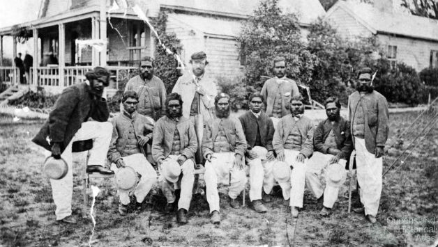 The Aboriginal cricket team of 1868 - Bripumyarrimin is at the front on the left, with his leg on the chair.