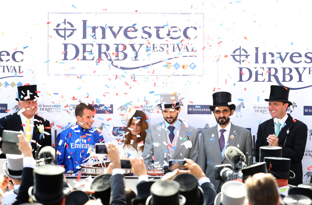 (L-R) Jockey William Buick, Princess of Dubai Sheikha Al Jalila bint Mohammed Al Maktoum, Crown Prince of Dubai Sheikh Hamdan, Godolphin owner Sheikh Mohammed celebrates his horse Masar winning the Investec Derby race with trainer Charlie Appleby on Derby Day at Epsom Downs