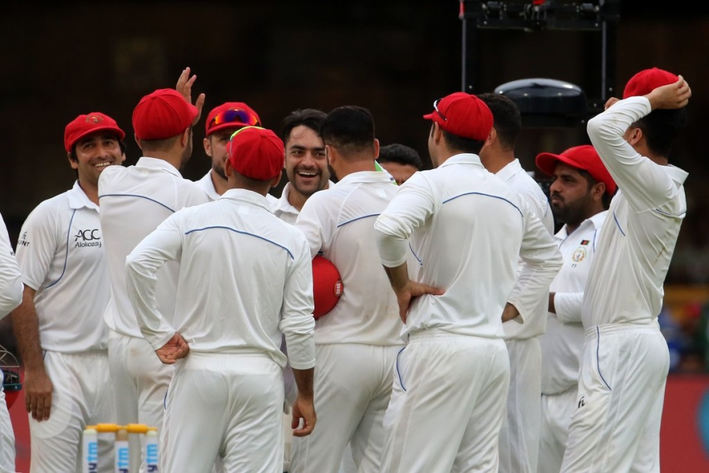 The Afghans in a huddle during the Test. Image - BCCI/Twitter.