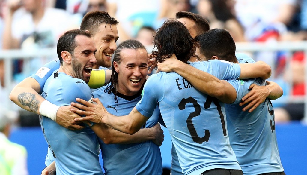 The dreadlocked Diego Laxalt is congratulated by his teammates.
