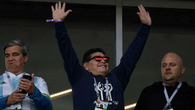 Diego Maradona waves