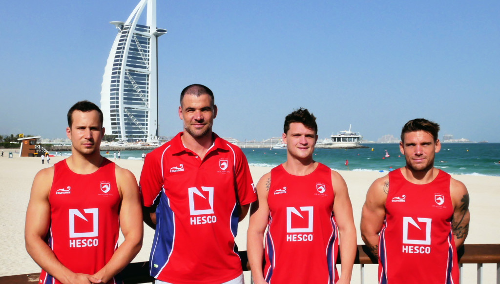 Mike Phillips (2nd l) pictured in Dubai with (from l) Dragons players James Love, skipper Ross Samson and Matt Richards shortly after his appointment.