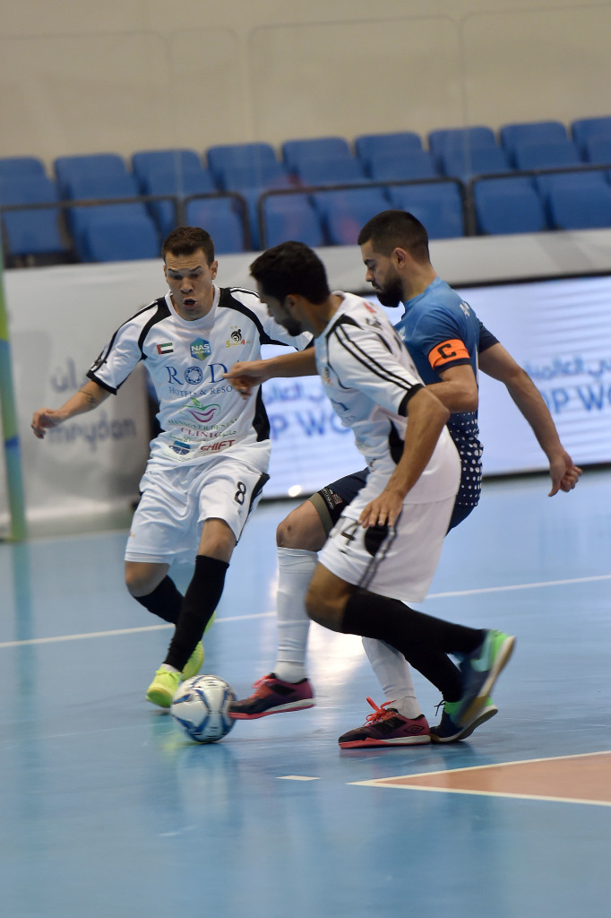 Al Bahri captain Ramirez Alonso Kevin (blue) tries to make his way past Douglas Dos Santos (No8) and Omar Juma of Sport 4 All in the quarterfinal of the NAS Futsal Championship.