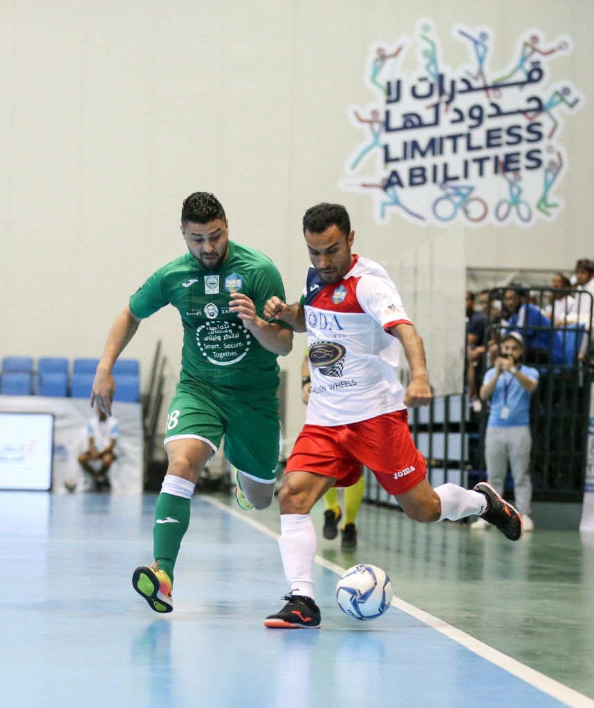 Dubai Police's Alex William Da Silva (green) jostles for the ball with Al Taher's Ali Asghar Hassanzadeh in the playoff for third place in the NAS Futsal Championship. Da Silva scored twice to help Dubai Police win 5-2.