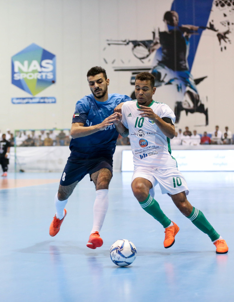 Emirates Driving Institute's Williams Oliver Do Nascimento (white) – winner of the Best Foreign Player award and the Golden Boot – battles for the ball with Al Bahri's Essam Alla Shamkh during the NAS Futsal Championship final.