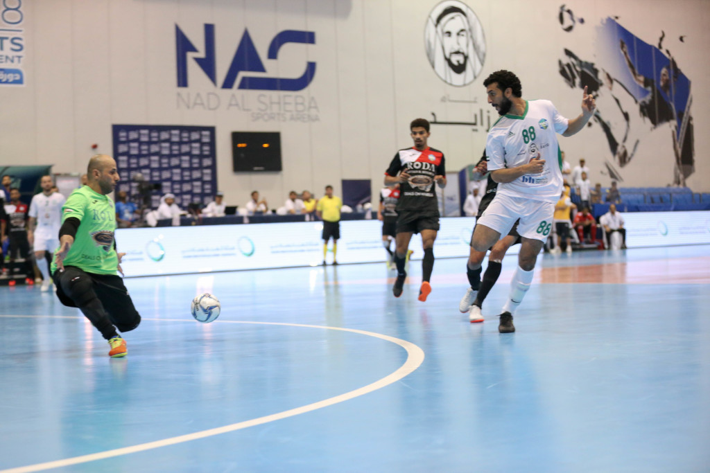 Emirates Driving Institute's Abdulkarim Jamil scores the only goal of their semi-final clash with defending champions Al Taher.