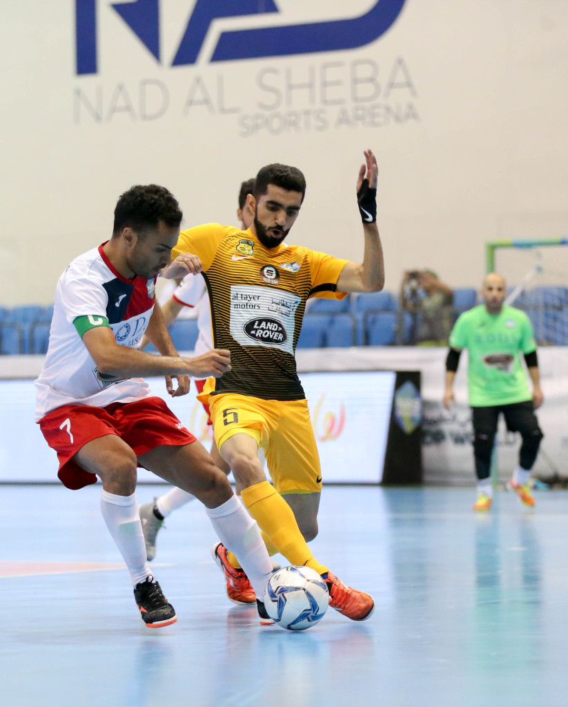Al Taher captain Ali Asghar Hassanzadeh battles for possession with Fuhood Zaabeel's Ahmed Al Hosany in their quarterfinal clash. Al Taher won 2-1.