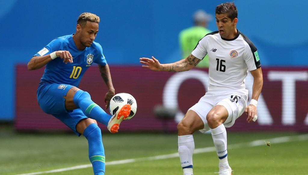 Cristian Gamboa (r) typified Costa Rica's tenacity.