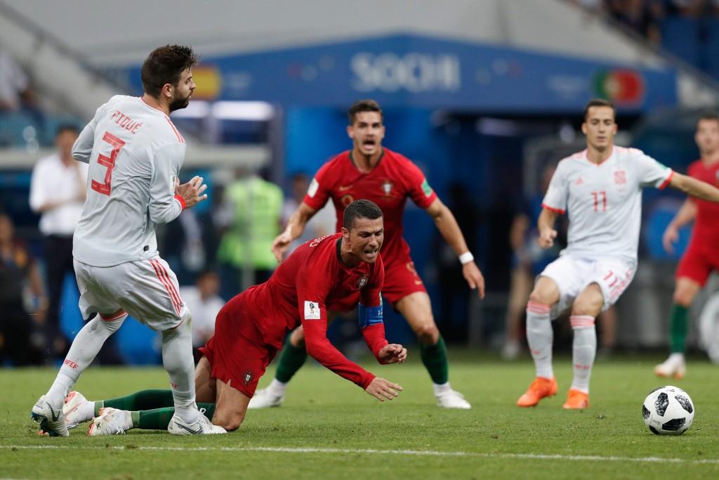 Gerard Pique and Cristiano Ronaldo clash during the match