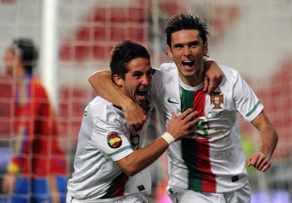 Portugal's striker Helder Postiga (R) ce