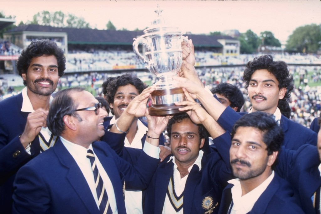 The Indians pose with the trophy on the Lord's balcony.