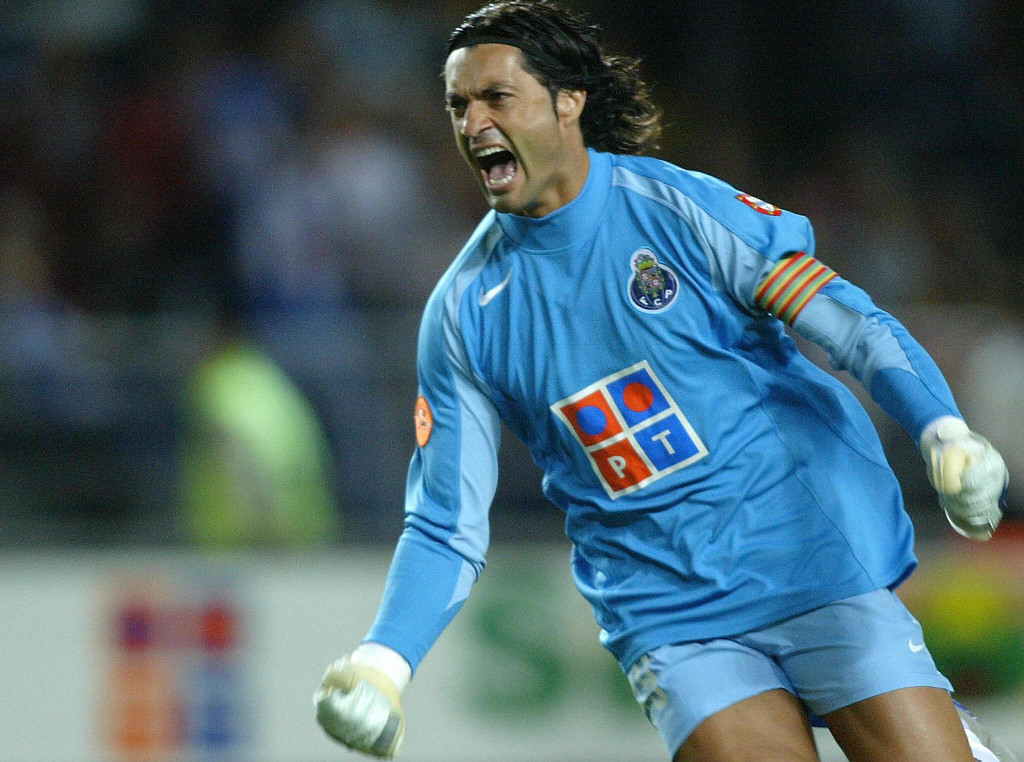 "COIMBRA, PORTUGAL: FC Porto goalkeeper Vitor Baia celebrates after scoring the first goal against SL Benfica's during the Supercup ""Candido de Oliveira"" match at Municipal Stadium in Coimbra, central Portugal, 20 August 2004. (Photo credit should read MIGUEL RIOPA/AFP/Getty Images)"