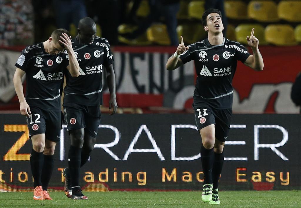 Diego (r) celebrates scoring for Reims against Monaco in Ligue 1 during 2016.