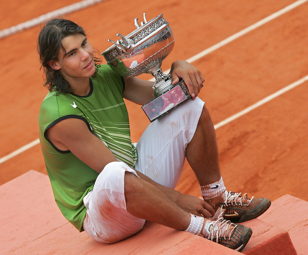 PARIS, France:  Spanish Rafael Nadal holds his trophy after his men's final match of the tennis French Open at Roland Garros against Argentinian Mariano Puerta, 05 June 2005 in Paris. Nadal won 6-7(6) 6-3 6-1 7-5.AFP PHOTO / CHRISTOPHE SIMON  (Photo credit should read CHRISTOPHE SIMON/AFP/Getty Images)